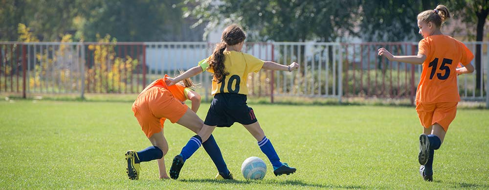 Youth Girls Playing Soccer