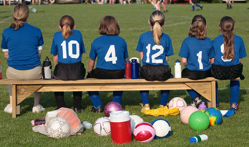 Youth Soccer Players Sitting on the Bench